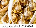 golden tumbler for pour water... | Shutterstock . vector #1153364149