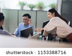 business people discussing in... | Shutterstock . vector #1153388716