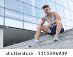 smiling young sportsman sitting ... | Shutterstock . vector #1153396939