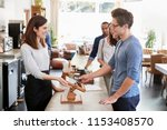 customer at the front of the... | Shutterstock . vector #1153408570