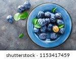 fresh juicy sweet plums on... | Shutterstock . vector #1153417459