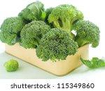Fresh green broccoli on light background, selective focus - stock photo