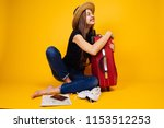 laughing young girl in a hat... | Shutterstock . vector #1153512253