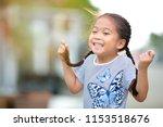 portrait of a cute asian little ... | Shutterstock . vector #1153518676