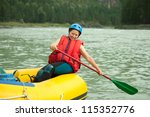 Girl With A Paddle On The Raft