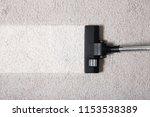 vacuum cleaner on carpet... | Shutterstock . vector #1153538389