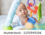 charming baby in blue body ... | Shutterstock . vector #1153545106