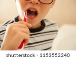 happy boy washes his hands with ...   Shutterstock . vector #1153552240