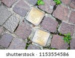 Small photo of ASCHAFFENBURG / GERMANY / JUNE 2018. Stolperstein or stumbling stone in Aschaffenburg. Two cobblestones remembering the victims of the deportation and killing by the Nazis during the second world war.