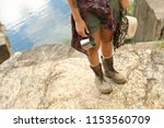 young woman with hat and metal... | Shutterstock . vector #1153560709