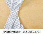 cell napkin om wooden table...   Shutterstock . vector #1153569373