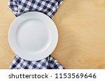 blue cell napkin on wooden...   Shutterstock . vector #1153569646