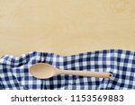 wood spoon with blue cell...   Shutterstock . vector #1153569883