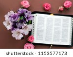 Bible And Flowers On White...