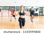 strong dedicated woman lifting... | Shutterstock . vector #1153595800