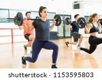female weightlifter lifting... | Shutterstock . vector #1153595803
