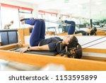 side view of flexible female... | Shutterstock . vector #1153595899