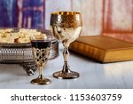Holy communion on wooden table on church. Cup of glass with red wine, bread on wooden table. Holy Bible