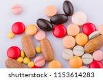 tablets pills capsule heap mix... | Shutterstock . vector #1153614283