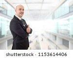 happy male doctor going thumb... | Shutterstock . vector #1153614406