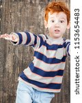 red haired boy with disheveled... | Shutterstock . vector #1153654483