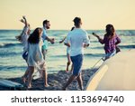 party on beach  happy young... | Shutterstock . vector #1153694740