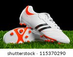 Soccer Shoes On The Green Gras...