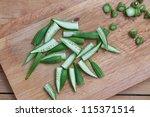 Cut Okra On A Cutting Board ....