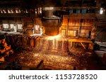 tank pours the liquid steel in... | Shutterstock . vector #1153728520
