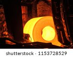 roll of hot metal on the... | Shutterstock . vector #1153728529