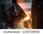 pouring of liquid metal in open ... | Shutterstock . vector #1153728550