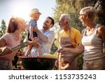 barbecue time.happy big family... | Shutterstock . vector #1153735243