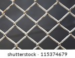 wire fence close up | Shutterstock . vector #115374679