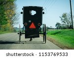 amish buggy on country road   Shutterstock . vector #1153769533