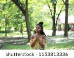 beautiful thoughtful ethnic... | Shutterstock . vector #1153813336