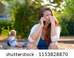 stressed depressed young mother ... | Shutterstock . vector #1153828870