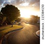 sunset  brisbane city streets   Shutterstock . vector #115384150