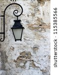 Iron Lantern On A Old Brick Wall