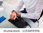 businessman holding painful...   Shutterstock . vector #1153859596