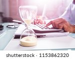 close up of hourglass in front... | Shutterstock . vector #1153862320