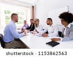 young man sitting at interview... | Shutterstock . vector #1153862563