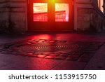 Red Neon Light Reflections On...