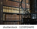 book shelves in long room of... | Shutterstock . vector #1153924690
