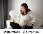 beautiful pregnant woman feel... | Shutterstock . vector #1153966909