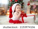 Cute Baby In Santa Hat Opening...