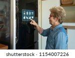 a senior asian woman is... | Shutterstock . vector #1154007226