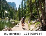 girls on summer vacation hiking ... | Shutterstock . vector #1154009869