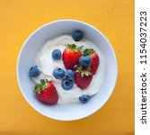yoghurt with strawberries and... | Shutterstock . vector #1154037223