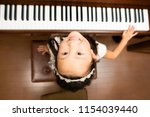 girl to play the piano | Shutterstock . vector #1154039440