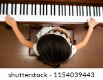 girl to play the piano | Shutterstock . vector #1154039443